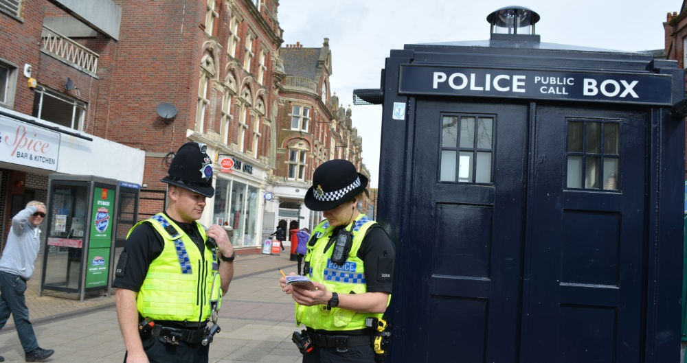 Dorset Police Officers in the street with a Police public call box
