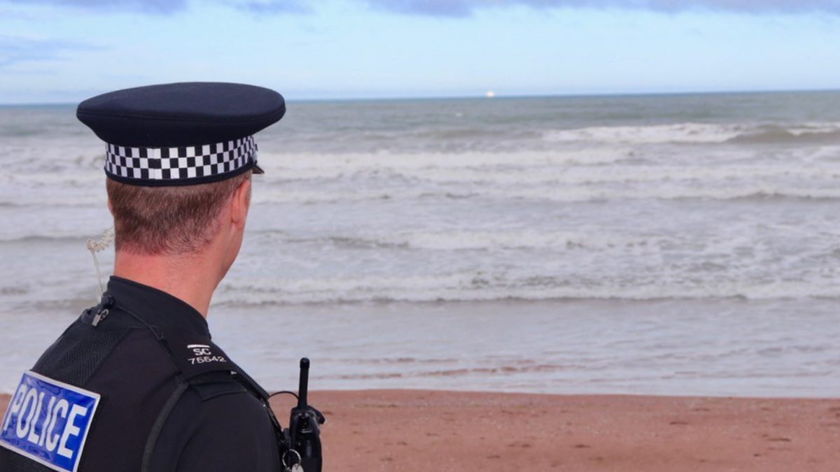 Special Constable looking out to sea