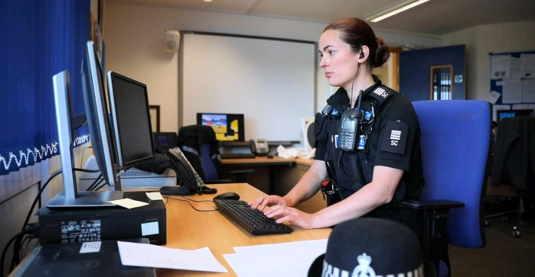 Special Constable completing admin duties at a computer