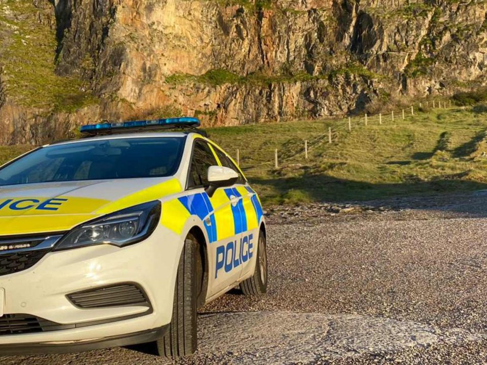 A Police Car parked by the cliffs