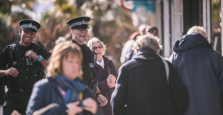 Police Officers laughing with members of the public