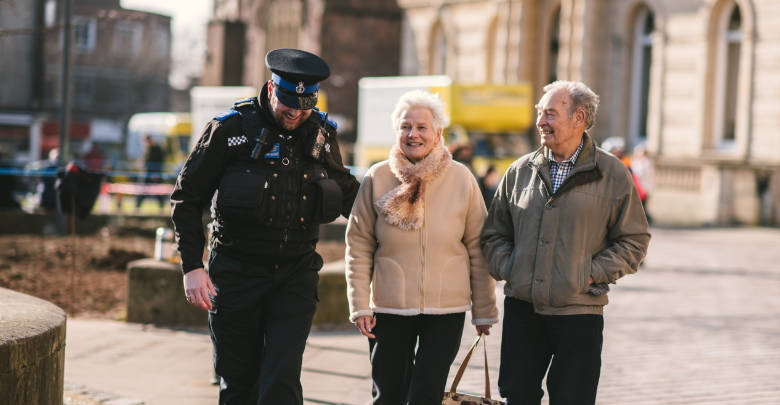 PCSO walking in the street with members of the public