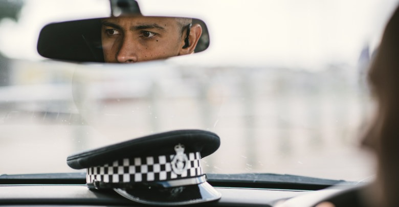 Police Officer driving a car