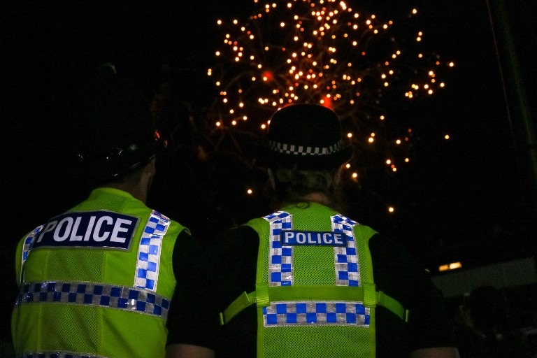 Two Special Constables look on at evening festivities
